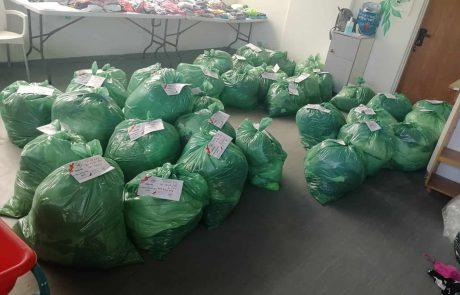 העדה היהודית הספרדית חילקה חבילות בגדים למשפחות נזקקות